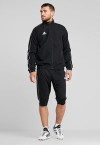 adidas Performance - CORE ELEVEN AEROREADY 3/4 SPORT PANTS - Träningsshorts 3/4-längd - black/white - 1