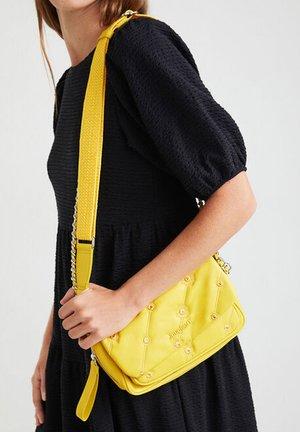 OJO DE TIGRE  - Across body bag - yellow