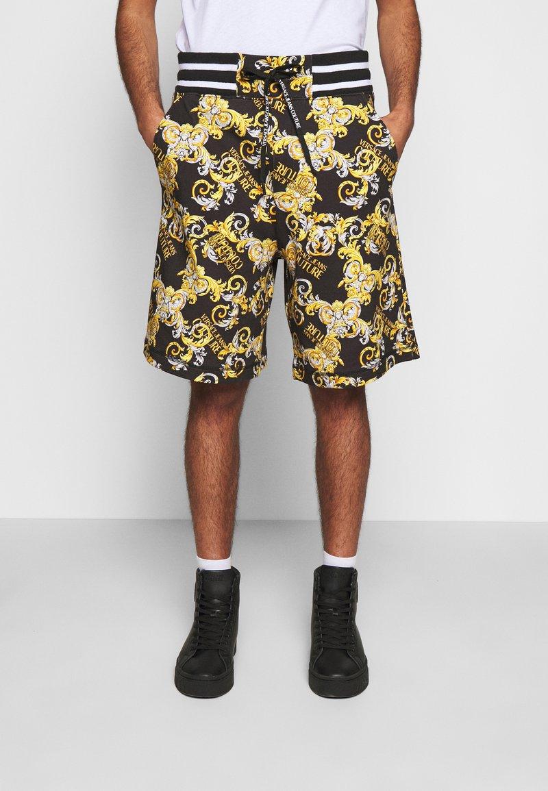 Versace Jeans Couture - PRINT NEW LOGO - Pantaloni sportivi - nero