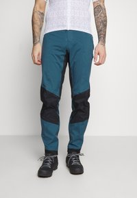 Patagonia - DIRT ROAMER STORM PANTS - Trousers - crater blue - 0