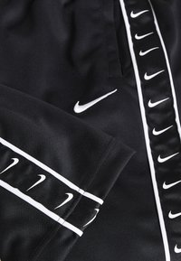 Nike Sportswear - TAPE - Shorts - black - 3