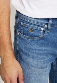 Calvin Klein Jeans - CKJ 026 SLIM - Slim fit jeans - bright blue - 4
