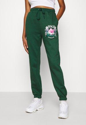TENNIS GRAPHIC JOGGER - Spodnie treningowe - green
