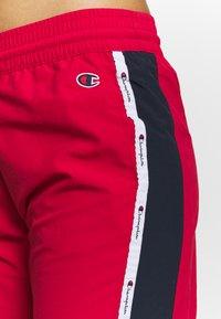 Champion - ELASTIC CUFF PANTS ROCHESTER - Pantalones deportivos - red - 4