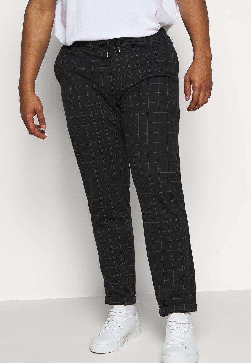 Jack´s Sportswear - CLUB PANTS ELASTIC WAIST - Tracksuit bottoms - black