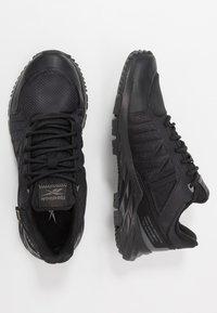 Reebok - ASTRORIDE TRAIL GTX 2.0 - Trail running shoes - black - 1