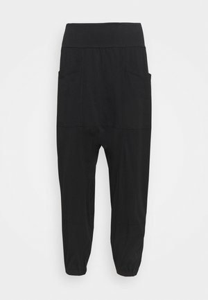 RELAXED YOGA PANTS - Tracksuit bottoms - black