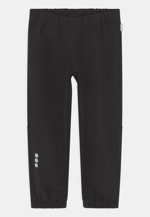 OIKOTIE UNISEX - Outdoorové kalhoty - black