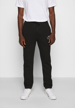 PETER TROUSERS - Spodnie treningowe - black