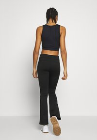 Ellesse - STORMY - Sports bra - black - 2