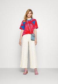 Marimekko - CREATED KUUSIKKO APPELSIINI - T-shirt print - bright blue/orange/pink - 1