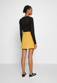 MINKPINK - LAPS AROUND THE SUN MINI SKIRT - A-line skirt - golden yellow - 2