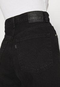 Levi's® - HIGH LOOSE - Jean flare - black denim - 6