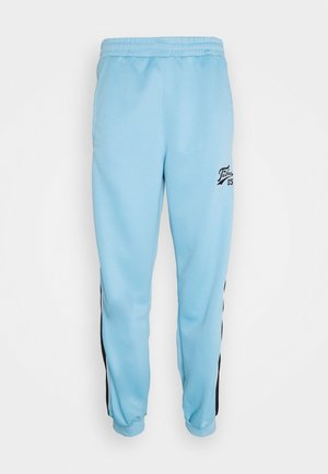 VARSITY TRACK PANTS - Tracksuit bottoms - lightblue