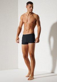 Superdry - Swimming shorts - black - 3