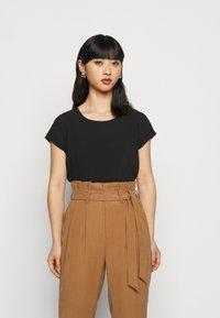 Vero Moda Petite - VMBOCA BLOUSE - Basic T-shirt - black - 0