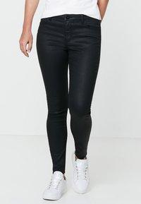 HALLHUBER - Jeans Skinny Fit - black denim - 0