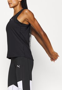 Puma - TRAIN FAVORITE RACERBACK - T-shirt de sport - black - 3