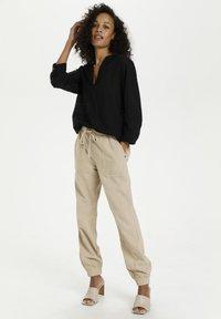 Kaffe - Trousers - classic sand - 1