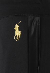 Polo Ralph Lauren - FEATHERWEIGHT - Tracksuit bottoms - black - 5