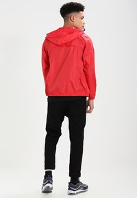 K-Way - CLAUDE 3.0 UNISEX  - Summer jacket - red - 2