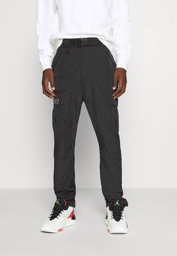 RETRO  PANTS CRINKLE - Cargo trousers - black