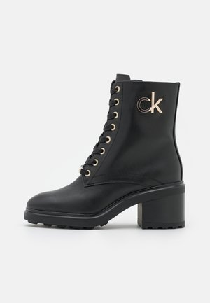CLEAT  - Lace-up ankle boots - black