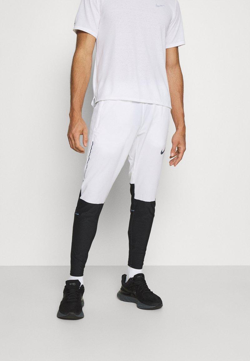 Nike Performance - SWIFT PANT - Träningsbyxor - white/black