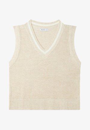 Stickad tröja - beige