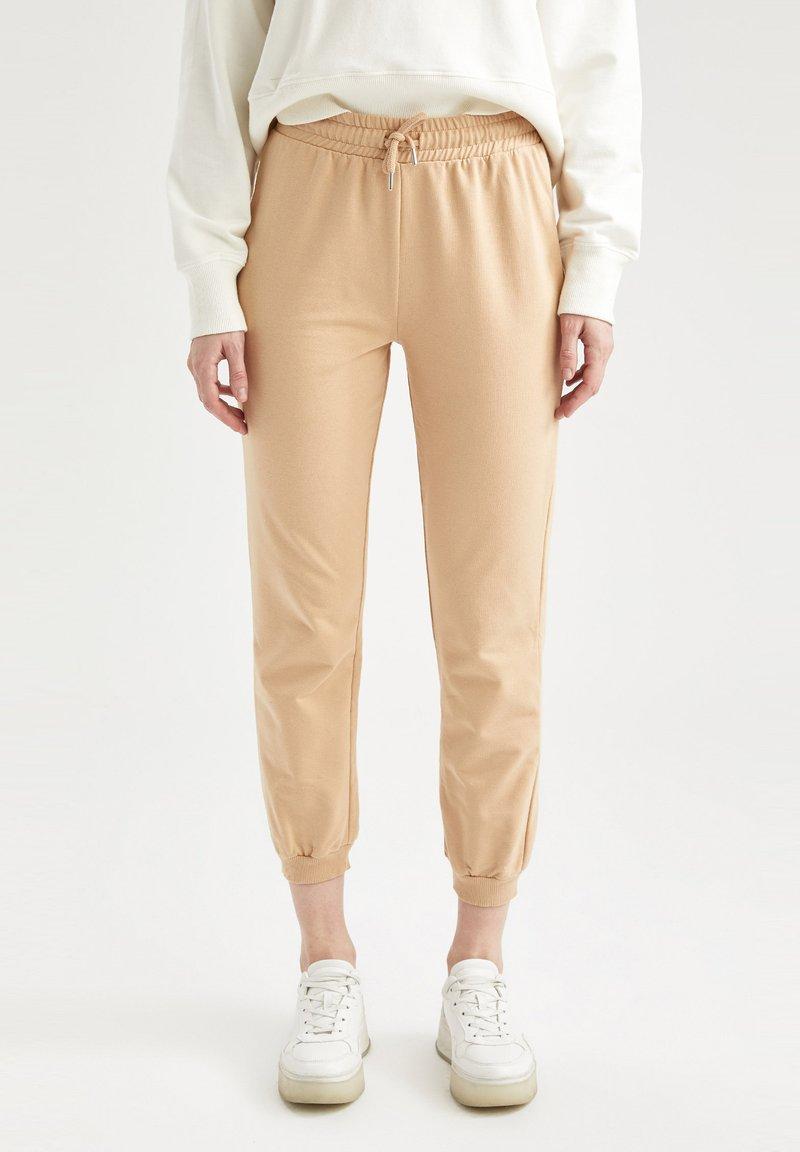 DeFacto - Tracksuit bottoms - beige