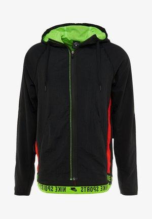 FLEX - Training jacket - black/electric green