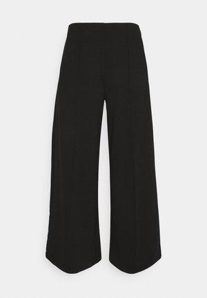 KATE - Trousers - black