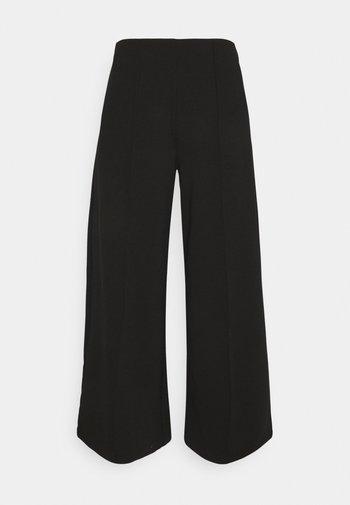 KATE - Pantaloni - black