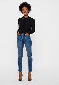 Vero Moda - JAPANISCHER - Button-down blouse - black - 1