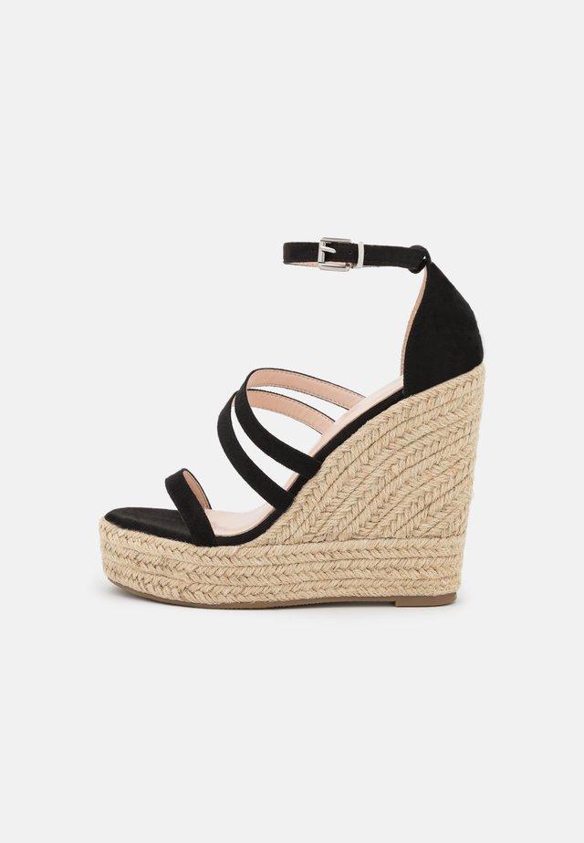 MIRELLE - Sandalen met plateauzool - black