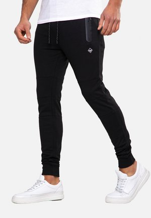 TRISTAIN  - Tracksuit bottoms - black