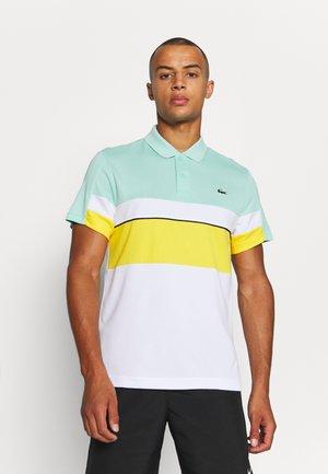 TENNIS TOUR - Polo - vert/jaune/blanc/noir