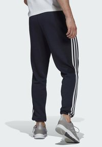 adidas Performance - ESSENTIALS FRENCH TERRY TAPERED 3-STRIPES JOGGERS - Træningsbukser - blue - 1