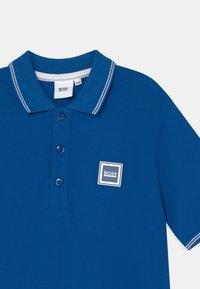 BOSS Kidswear - Poloshirts - pale blue - 2