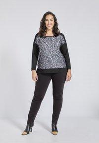 SPG Woman - Longsleeve - black - 1