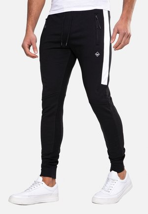 DWAYNE - Trainingsbroek - black