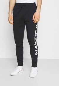 NAUTICA COMPETITION - PINISI - Tracksuit bottoms - black - 1