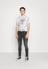 Nudie Jeans - TIGHT TERRY UNISEX - Jeans Skinny Fit - fade to grey - 1