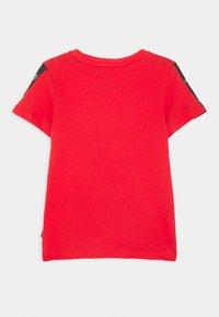 Puma - AMPLIFIED TEE  - Print T-shirt - red - 1