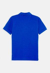 Calvin Klein Jeans - LOGO COLOUR BLOCK  - Poloshirts - blue - 1