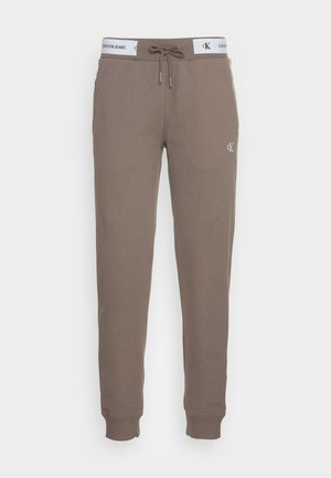TRACK PANT - Tracksuit bottoms - dusty brown