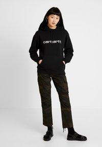 Carhartt WIP - CYMBAL PANT COLUMBIA - Trousers - evergreen - 1