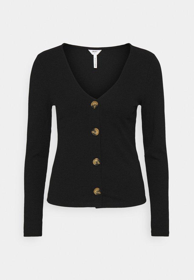OBJTHELMA - Vest - black