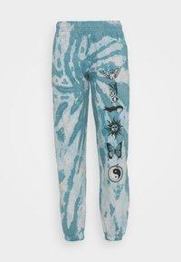 NEW girl ORDER - TIE DYE ETCHED GRAPHIC JOGGER - Teplákové kalhoty - dark blue - 0