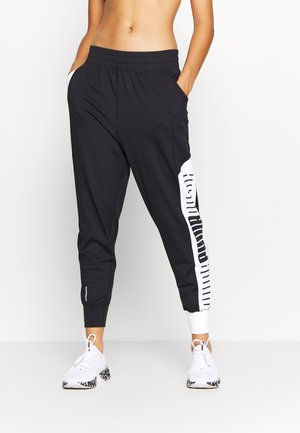 TRAIN STRETCH TRACK PANT - Tracksuit bottoms - black/white